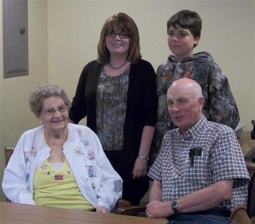 Ms. Tardiff, her son Travis, her father, and grandmother